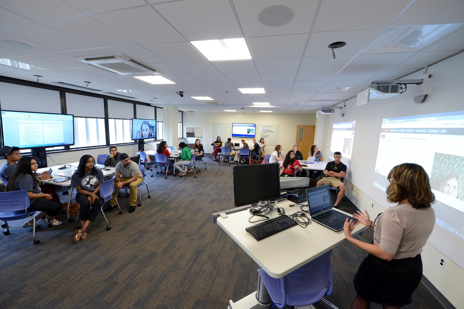 A classroom full of students sit listening to their professor. Swirbul Library comes equipped with state-of-the-art technology within all of it's classroom settings.